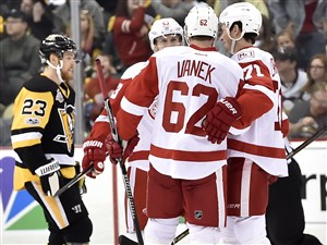 Detroit's Darren Helm and Dylan Larkin congratulate Thomas Vanek on a goal against the Penguins in the third period Sunday at PPG Paints Arena.