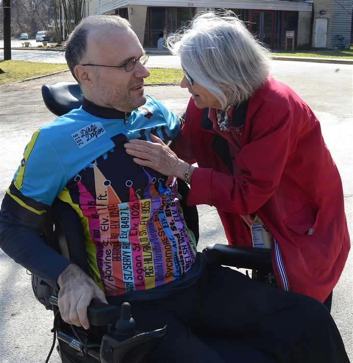 20170219ng-DannyChew2-1 Danny Chew gets a hug from his mother, Sally, at the Bud Harris Cycling Track on Sunday in Highland Park.