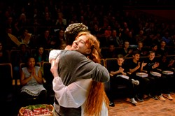 Logan Shiller, left, of Pittsburgh CAPA, and Carolyn Jerz, homeschooled, embrace after being named co-winners of the Pittsburgh Public Theater's 2017 Shakespeare Monologue & Scene Contest's Upper Division Monologue category at the O'Reilly Theater.