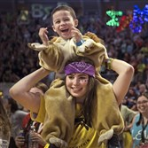 Romeo Rodriguez, 4, the brother of a THON child, dances on the shoulders of Mackenzie Cohen, of Dancer Relations at THON Friday.