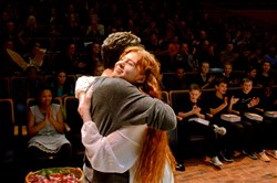 Logan Shiller, left, CAPA, and Carolyn Jerz, homeschooled, embrace after being named co-winners of the Pittsburgh Public Theater's 2017 Shakespeare Monologue & Scene Contest's Upper Division Monologue category at the O'Reilly Theater in Downtown Pittsburgh on Monday, Feb. 20, 2017.