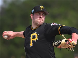 Pirates right-hander Pat Light delivers during live batting practice Feb. 20 at Pirate City in Bradenton, Fla.