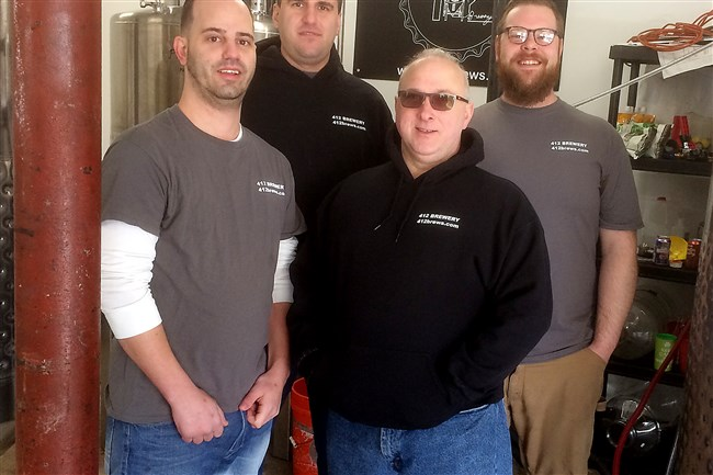 The team behind the new 412 Brewery in McKees Rocks: From left, Scott Davis, Sam Mure, Ed Wojtaszek and Adam Crabtree. They will be pouring samples of their first two bees at the Pittsburgh Winter Beerfest.