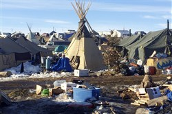 In this Thursday, Feb. 16, 2017, photo, debris is piled on the ground awaiting pickup by cleanup crews at the Dakota Access oil pipeline protest camp in southern North Dakota near Cannon Ball. The camp is on federal land, and authorities have told occupants to leave by Wednesday, Feb. 22 in advance of spring flooding. (AP Photo/Blake Nicholson)
