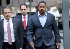 Joey Porter arrives for his preliminary hearing today at the Municipal Court building in Downtown. At far left is his attorney Robert Del Greco Jr.