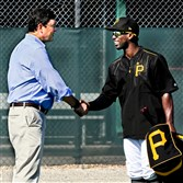 Pirates owner Bob Nutting shakes hands with right fielder Andrew McCutchen before workouts Monday in Bradenton, Fla.
