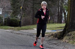 Peg Pardini, of Mt. Lebanon, runs through part of her neighborhood during her workout.