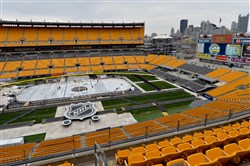 Crews uncover the ice Tuesday at Heinz Field. By the time the puck drops Saturday for the Penguins game against the Philadelphia Flyers, likely 60,000-plus fans will be taking it all in at this unlikely venue for hockey.