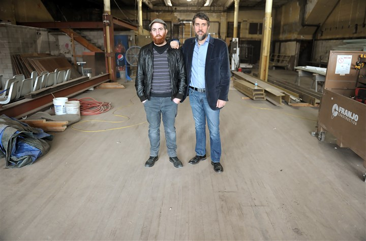 20170221ppHomesteadBrewery2LOC-1 Victor Rodriguez and his brother David stand inside the former Levine Brothers Hardware store in Homestead that they are renovating into a craft brewery and tapas restaurant in Homestead.