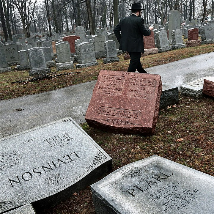AP_17052682704790 Rabbi Hershey Novack of the Chabad center walks through Chesed Shel Emeth Cemetery in University City on Tuesday, where almost 200 gravestones were vandalized over the weekend