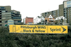 The  vinyl Sprint advertising sign on Mt. Washington Wednesday, February 22, 2017, as seen from the North Side, Pittsburgh. The city of Pittsburgh is demanding that Lamar Advertsing remove the sign after the zoning board of adjustment found that the banner violated the law.  (Rebecca Droke/Post-Gazette)
