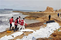 This Monday photo provided by The International Federation of Red Cross and Red Crescent Societies shows the bodies of people that washed ashore and were recovered by the Libyan Red Crescent near Zawiya, Libya.
