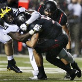 Michigan defensive end Taco Charlton sacks Rutgers quarterback Chris Laviano Oct. 8.