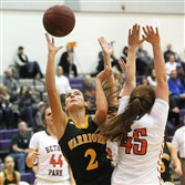 Mackenzie Aunkst (2) from Penn-Trafford, leaps between two defensive players for a shot at Baldwin High School as Bethel Park  defeated Penn-Trafford, 38-36.