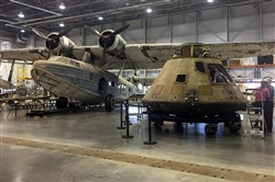 The Apollo 11 capsule sits in the restoration hanger at the National Air and Space Museum's Steven F. Udvar-Hazy Center in Chantilly, Va., ahead of a planned four-city tour. The airplane at left is the only aircraft in the Smithsonian's collection that was stationed at Pearl Harbor on Dec. 7, 1941.