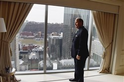 "Howard ""Hoddy"" Hanna III, chairman of Howard Hanna Real Estate Services, looks at the view of the city from the penthouse at The Residences in Three PNC Plaza, Downtown."