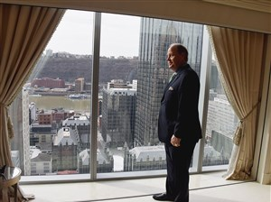 """Howard """"Hoddy"""" Hanna III, chairman of Howard Hanna Real Estate Services, looks at the view of the city from the penthouse at The Residences in Three PNC Plaza, Downtown."""