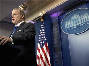 White House press secretary Sean Spicer speaks during the daily press briefing at the White House in Washington. The Trump administration could revise or withdraw an Obama-era directive requiring public schools to let transgender students use bathrooms and locker rooms that match their chosen gender identity.