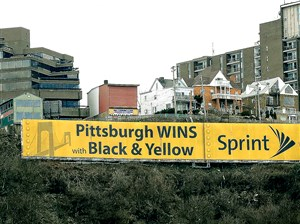 The vinyl Sprint advertising sign on Mt. Washington Wednesday as seen from the North Side, Pittsburgh. The city of Pittsburgh is demanding that Lamar Advertising remove the sign after the zoning board of adjustment found that the banner violated the law.