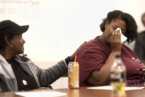 Carissa Mallory, left, comforts her crying daughter, Janell, on Tuesday at an Affordable Care Act town hall for Rep. Tim Murphy on Tuesday at the Washington County Courthouse. Mr. Murphy, an Upper St. Clair Republican, did not attend the event.