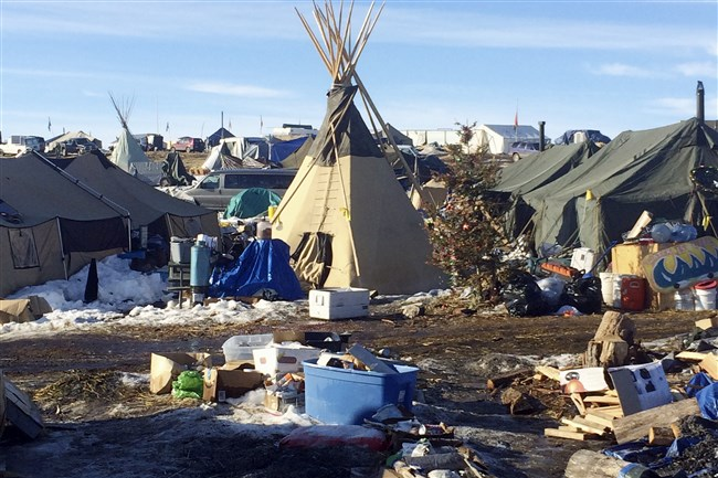 In this Thursday photo, debris is piled on the ground awaiting pickup by cleanup crews at the Dakota Access oil pipeline protest camp in southern North Dakota near Cannon Ball. The camp is on federal land, and authorities have told occupants to leave by Wednesday, Feb. 22 in advance of spring flooding.