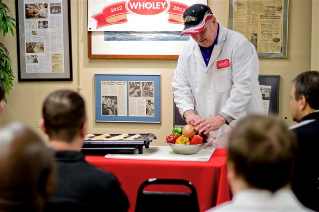 Ned Carroll, a 34-year veteran seafood expert at Wholey's fish market, leads a seafood class. Classes are free for customers every Saturday morning at the Strip District store.