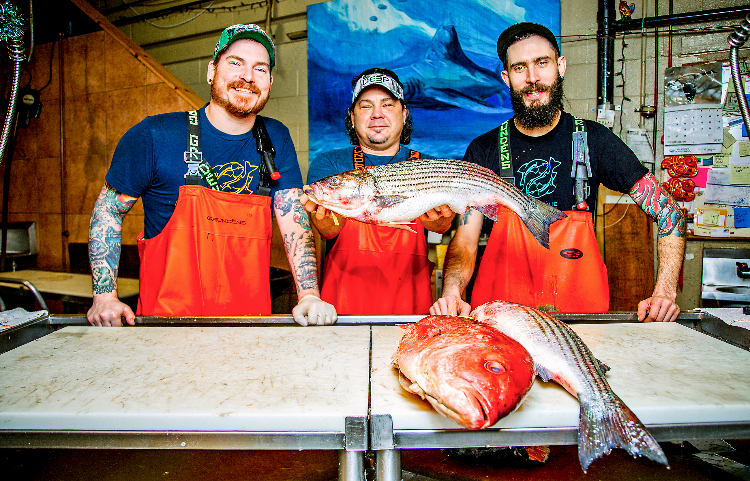 20170222arFishinStrip05-3 From left, Tim Reynolds, senior fishmonger, Henry Dewey, owner and Kyle Houghtelin, fishmonger, at Penn Avenue Fish Co.
