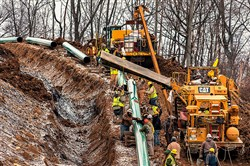 "In this file photo, workers lay a stretch of the Mariner East 2 pipeline in Washington County, Pa. Pennsylvania environmental officials have ordered Sunoco to halt construction of the natural gas pipeline, citing a series of spills and other ""egregious and willful violations"" of state law."