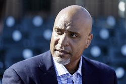 Tony Clark, head of the baseball players' union, talks to the media before a spring training baseball game between the Detroit Tigers and the Washington Nationals in Lakeland, Fla.