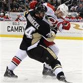 Penguins winger Tom Kuhnhackl battles with Hurricanes Ron Hainsey in January 2016. Hainsey is the newest Penguin after a trade Thursday.