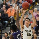 Butler's Ethan Morton (25) shoots a 3-pointer at North Allegheny high school on Wednesday. Butler defeated Baldwin High School 71-62.