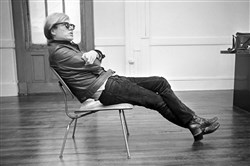 Andy Warhol sits in his favorite chair in New York, Feb. 27, 1968.  Taped conversations between him and Truman Capote about a Broadway play that never happened inspired a show that will open this fall.