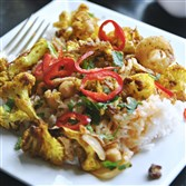 Vadouvan-Roasted Cauliflower With Harissa Chickpea Curry is a spicy bowl of vegetarian goodness.