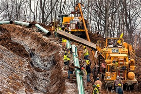 Workers lay a stretch of the Mariner East 2 pipeline in Washington County, Pa. The Mariner East 1 pipeline has been allowed to resume ferrying natural gas liquids from southwestern Pennsylvania across the state, but two pipelines under construction along the same route remain on hold.