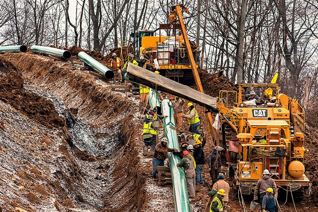 Workers lay a stretch of the Mariner East 2 pipeline in Washington County, Pa. The pipeline is to extend to Marcus Hook.