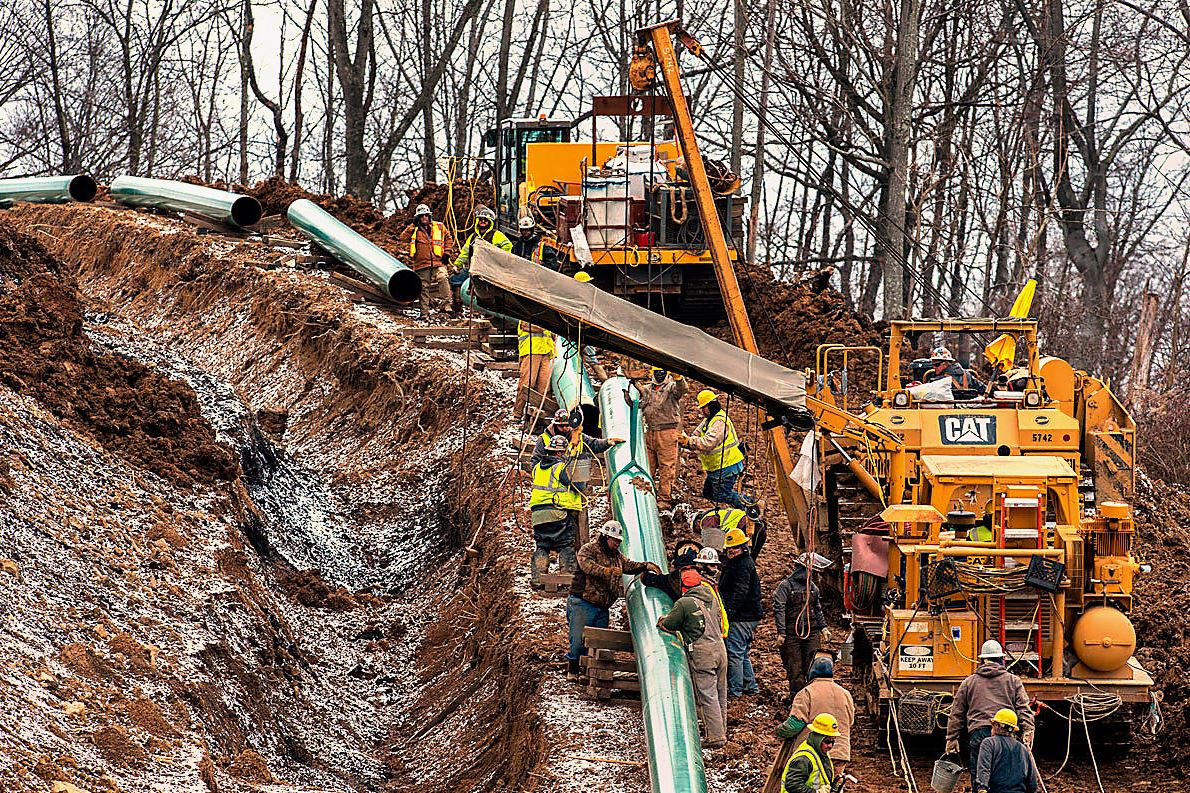 sunoco.jpg Workers lay a stretch of the Mariner East 2 pipeline in Washington County, Pa. The pipeline is to extend to Marcus Hook.