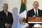 Homeland Security Secretary John Kelly, right, accompanied by Secretary of State Rex Tillerson, speaks at the Mexican Ministry of Foreign Affairs in Mexico City on Thursday.