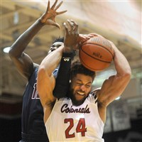 Robert Morris forward Aaron Tate fights for the ball Thursday against Fairleigh Dickinson at Sewall Center.