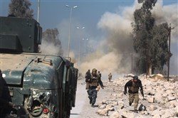 Smoke billows as Iraqi forces attack Mosul airport during an offensive to retake the western side of the city from jihadis of the Islamic State group Thursday.