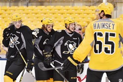 Left to right: Evgeni Malkin, Carl Hagelin, Sidney Crosby and Ron Hainsey practice Friday for the game against the Flyers in the Stadium Series at Heinz Field.