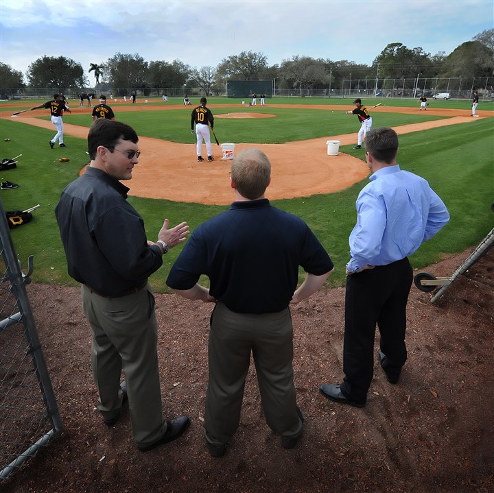 Nutting Huntington Pirates owner Bob Nutting, left, general manager Neal Huntington and president Frank Coonelly, right, huddle behind home plate to watch the workouts in 2010 at Pirate City in Bradenton, Fla.