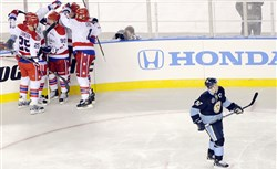 Capitals celebrate a goal by Eric Fehr in the third period as Penguins Sidney Crosby skates away on Jan. 1, 2011.