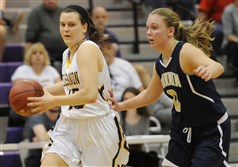 Mt. Lebanon's Kate Sramac, drives past Norwin's Magen Polczynski in the WPIAL quarterfinal Friday night.