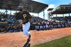 Starling Marte runs out of the dugout to center against the Orioles Saturday at Lecom Park.