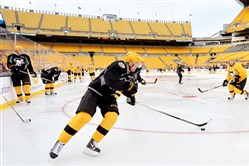 Patric Hornqvist, center, and the Penguins prepare for a game Saturday night against the Philadelphia Flyers at Heinz Field.