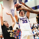 Chartiers Valley's Caleb Zajicek takes a shot as he's defended by Gateway's John Paul Kromka, #33 as Chartiers Valley defeats Gateway in the WPIAL quarterfinal at Baldwin High School.