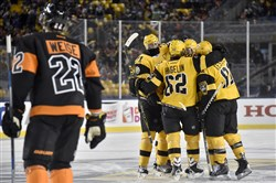 Penguins teammates congratulate Chad Ruhwedel on a goal against the Flyers on Feb. 25 at Heinz Field.
