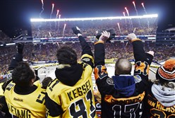Fans cheer before the start of the Penguins game against the Philadelphia Flyers Saturday at Heinz Field.