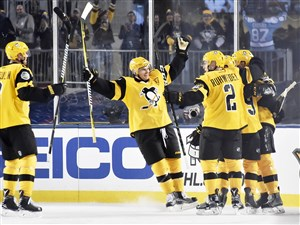 Penguins players celebrate a goal by Nick Bonino against the Philadelphia Flyers in the second period of the Stadium Series Saturday at Heinz Field.