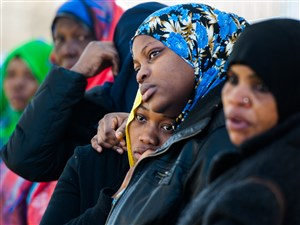 Women hold each other as Somali Bantu cab driver Ramadhan Mohamed, 31, of Northview Heights is buried Sunday in Chartiers Cemetery in Carnegie.